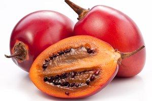 Tamarillo fruits with slice on white background.
