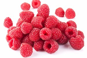 Ripe raspberries isolated on a white background.