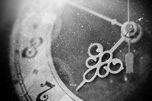Vintage grunge clock face with vintage roman numerals, black and white photo
