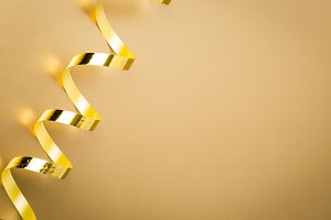 Golden ribbon on golden background