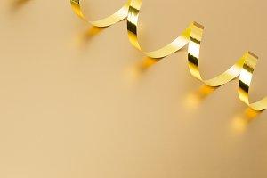 Golden ribbon on golden background