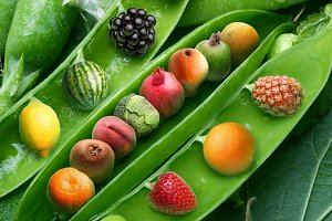 Creative pea with different fruits