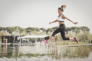 Athletic woman jumping in the park