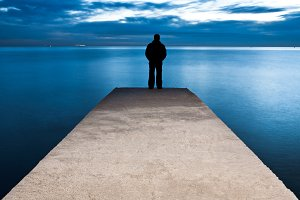 Man is standing on a jetty