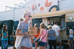 Girl at a food truck festival