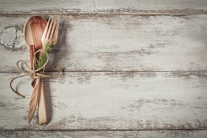 Cutlery on vintage wooden background