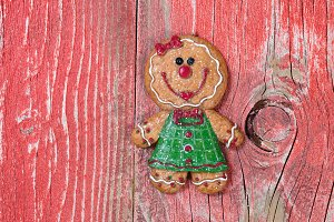 Xmas Gingerbread Cookie on red wood