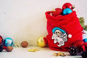 Christmas Composition red and yellow ballsin bag , snowflakes . Vintage style. toning