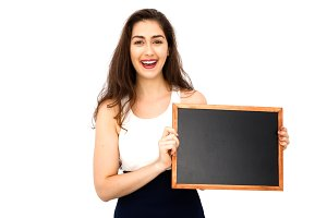 Beautiful Caucasian woman holding empty blackboard over white background - ready to fill text