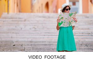 Woman looking touristic citymap Rome