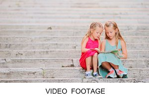 Beautiful kids on steps with citymap