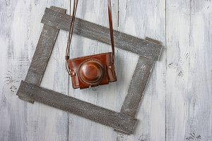 Old camera in a leather case