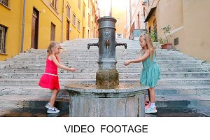 Kids have fun at street fountain