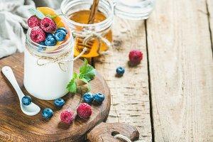 White yogurt in jar & fresh berries