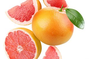 Falling grapefruit and grapefruit slices.  Isolated on a white.