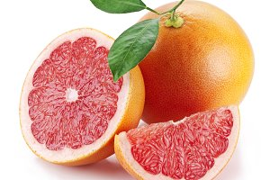 Grapefruit with slices on a white
