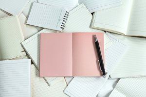Note pad background with one pink