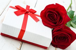 White gift box and red rose