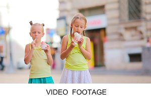 Cute kids eating italian ice-cream