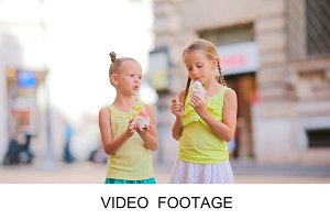 Adorable kids enjoying ice-cream