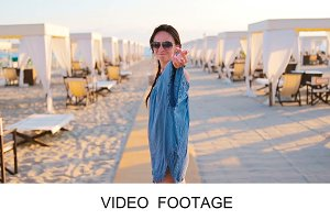 Young beautiful woman walk on beach