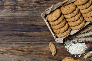 Oatmeal cookies on wooden background in rustic style