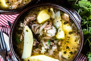 Traditional chilean latinamerican meat soup ajiaco served in clay plate
