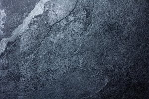 Black stone slate background texture