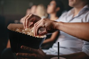 Young people eating popcorn