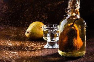 Chilean brandy with whole pear inside bottle. Aguardiente de pera.