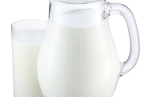 Pitcher and glass of milk on a white background