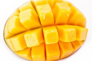 Slice of mango on a white background.