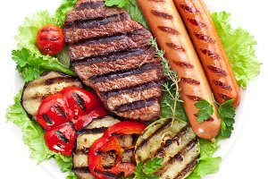 Grilled steak,sausages and veget