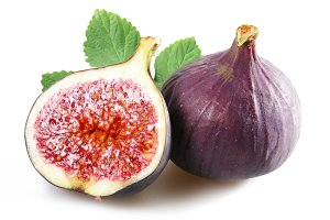 Figs with cut fruit and leaves on a white background