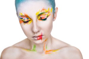 Portrait of a woman with creative colorful makeup