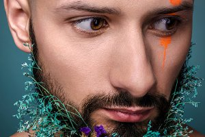 Portrait of a man with creative colorful makeup