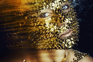 girl with gold fashion make-up