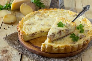 pie with potatoes, meat and cheese