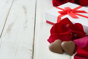 White gift box, roses and chocolate