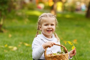 Little girl with wicker basket.