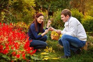 Couple in autumn park.