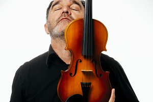 Violinist mature embracing a violin