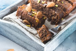 Chocolate cake with persimmons and almonds. Closeup