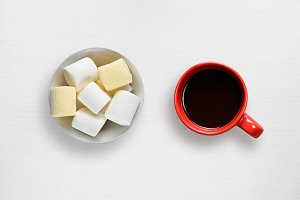 Marshmallow and coffee cup on table
