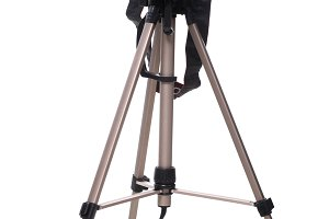 Photo camera on tripod isolated