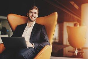 smiling successful man entrepreneur