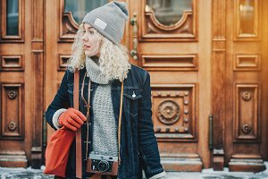 Young blond curly girl tourist