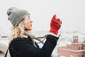 blond curly female in red gloves