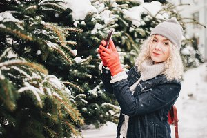 Young blond female in red gloves