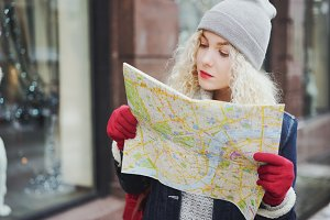 female tourist looking into map